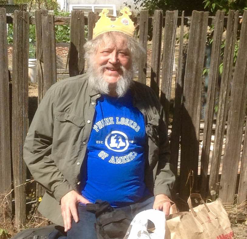 """Since September is """"National Hobo Month"""", I propose that all listeners purchase a PLA t shirt and give it to a hobo. I did and by crackee I feel good about it.. Attached is a photo of a hobo that has been frequenting the neighborhood since spring. I gave him a PLA T-shirt, 5 dollars, a pack of smokes and crowned him """"King of the Hobos"""". His joy brought tears to my eyes. I encourage all listeners when they purchase a t-shirt, buy another for a hobo of your choice . Already have a PLA Shirt, then buy another for a hobo. Make the world a little bit better. -Mr Hunga Dunga The Peoples Karma Squad."""